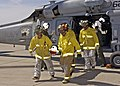 US Navy 050513-N-7286M-049 Fire Fighters from Naval Air Facility El Centro Federal Fire Department, receive a patient during Exercise Desert Steam.jpg