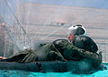 US Navy 050623-N-9500T-183 A student attending the refresher course in water survival at Aviation Survival Training Center, Marine Corps Air Station Miramar, awaits simulated rescue.jpg