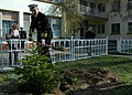 US Navy 070207-N-0577G-007 Captain Chip Walter, Commander Task Force 67 (CTF-67), plants a tree in the playground of a local school. Bulgarians believe just as a tree needs care, love, and attention to properly grow so does a c.jpg