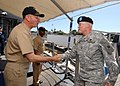 US Navy 070214-N-4965F-001 USS Lake Erie (CG 70) Commanding Officer, Capt. Randall Hendrickson, greets U.S. Army Pacific (USARPAC) Command Chaplain, Col. Chip Fowler on the ship's quarterdeck during a visit.jpg