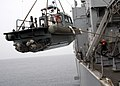 US Navy 070220-N-6710M-005 Sailors on board dock landing ship USS Tortuga (LSD 46) work together to recover a small boat from the ship's port side.jpg