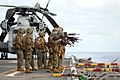US Navy 070530-N-4207M-140 Marines attached to the 31st Marine Expeditionary Unit conduct marksmanship training over the portside elevator aboard the amphibious assault ship USS Essex (LHD 2).jpg