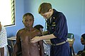 US Navy 070809-N-9195K-011 Cmdr. Elizabeth Satter uses a stethoscope to listen to a local man's breathing during a medical civic action program (MEDCAP) at Bunabun Heath Center.jpg