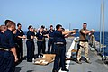 US Navy 080602-N-7987H-001 Midshipmen embarked aboard the amphibious dock landing ship USS Ashland (LSD 48) participate in a weapons qualification for the 9mm pistol.jpg