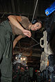 US Navy 080604-N-7987H-061 Gas Turmbine System Technician (Electrical) Andrea Deese, assigned to Assault Craft Unit Four (ACU-4) ties down equipment before launching a Landing Craft Air Cushion (LCAC) vessel.jpg