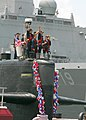 US Navy 080628-N-7705S-056 Troy Jackson, commanding officer, and the crewmembers of the fast-attack submarine USS Norfolk (SSN 714) wave to the families and friends on the pier as they return to Naval Station Norfolk following.jpg