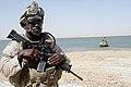 US Navy 080711-M-1391M-035 Machinist's Mate Fireman Samuel Duodu, assigned to Riverine Squadron (RIVRON) 3, posts a security watch.jpg