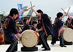 US Navy 090404-N-2560Y-003 Members of the Yokohama Hayato High School taiko drum team perform for more 25,000 guests during the Naval Air Facility Atsugi, Japan annual cherry blossom festival.jpg