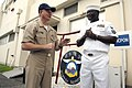 US Navy 090707-N-9818V-031 Master Chief Petty Officer of the Navy (MCPON) Rick West speaks with a Sailor assigned to the Aircraft Intermediate Maintenance Department at Naval Air Facility Atsugi, Japan during his visit to the b.jpg