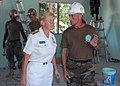 US Navy 090710-N-5207L-494 Chief Builder Eric Johnson of Naval Mobile Construction Battalion (NMCB) 40 updates Rear Adm. Nora Tyson, Commander, Logistics Group Western Pacific, on a new multi-use room being built at Ban Khao By.jpg