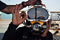 US Navy 090805-N-4220R-011 A Royal Brunei Navy diver signals after being fitted with a KM -37 dive helmet by members of U.S. Navy Mobile Diving and Salvage Unit (MDSU) 1 during training aboard the Navy Sealift Command rescue an.jpg