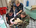 US Navy 090910-N-8138M-002 Navy physician CDR LLoyd G. Burgess, Naval Hospital Sigonella, Sicily, right, and Navy nurse LT j.g. Kevin A. Lelacheur, Naval Hospital Jacksonville examine a child during an Africa Partnership Statio.jpg