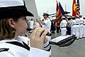 US Navy 091107-N-7478G-227 Musician Seaman Danielle Clark plays the piccolo as the U.S. 7th Fleet ceremonial band plays the national anthems of the U.S. and Vietnam.jpg