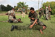 US Navy 091203-M-6217B-767 Members of the Belize Defense Force practice enemy prisoner-of-war handling techniques