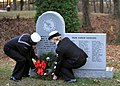 US Navy 091207-N-5082P-030 Aviation Boatswain's Mate (Handling) Airman Coy L. Dreher and Aviation Boatswain's Mate (Equipment) 3rd Class Caitlin A. Fitzgerald lay a wreath on the Pearl Harbor memorial at the Mariner's Museum.jpg