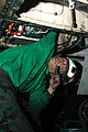 US Navy 091214-N-3327M-045 Aviation Machinist's Mate 2nd Class Raynard Eugenio performs maintenance on an F-A-18C Hornet.jpg
