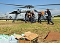 US Navy 100117-N-6247V-029 Sailors attached to the aircraft carrier USS Carl Vinson (CVN 70) load water and boxes of meals ready-to-eat (MREs) onto a SH-60S Sea Hawk helicopter of Helicopter Anti-submarine Squadron (HS) 7.jpg