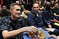 US Navy 100605-N-5712P-087 Capt. John Bruening, left, commodore of Amphibious Squadron (PHIBRON) 8, samples a lumpia roll.jpg