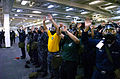US Navy 100914-N-2515C-097 Sailors raise their arms, signifying that they have successfully donned their MCU-2P gas mask during chemical, biologica.jpg