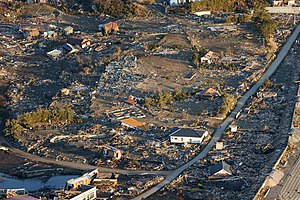 US Navy 110318-N-0076O-004 An aerial view of damage to northern Honshu, Japan, after a 9.0 magnitude earthquake and subsequent tsunami devastated t.jpg