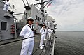 US Navy 110511-N-TB177-384 Sailors assigned to the guided-missile cruiser USS Gettysburg (CG 64) man the rails on the ship's fantail while departin.jpg