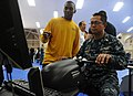 US Navy 110513-N-VE260-020 Aviation Electrician's Mate 2nd Class Johnny Guante instructs Senior Chief Culinary Specialist Celestino Angeles as he u.jpg