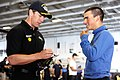 US Navy 110816-N-AU622-065 NASCAR driver Carl Edwards signs an autograph for Airman Kyle O' Brian in the hanger bay of aircraft carrier USS Dwight.jpg