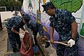 US Navy 110930-N-EA192-018 Sailors assigned to the guided-missile destroyer USS Mustin (DDG 89) clean a gutter near a playground at the Jong Deok.jpg