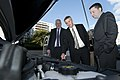 US Navy 111020-N-PM781-009 Tom Hicks, center, Deputy Assistant Secretary of the Navy for Energy, looks at the engine of a Chevrolet Volt electric c.jpg