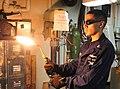 US Navy 111106-N-EZ913-299 Sailor ignites an acetylene torch aboard aircraft carrier USS John C. Stennis.jpg