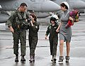 US Navy 111119-N-VE260-213 Cmdr. William Gotten, executive officer of Strike Fighter Squadron (VFA) 195, walks with his family during a homecoming.jpg