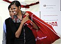 US Navy 111216-F-ZE674-110 First lady Michelle Obama visits Joint Base Anacostia-Bolling to sort toys for the Toys for Tots charity.jpg