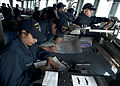 US Navy 120112-N-NL401-121 The bridge crew of the guided-missile destroyer USS James E. Williams (DDG 95) maneuvers the ship during a live-fire sho.jpg