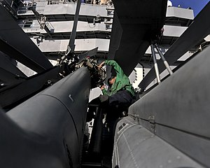 US Navy 120120-N-JN612-042 Aviation Electrician's Mate Airman Erik Gonzalez conducts maintenance on the rotor head of an MH-60S Sea Hawk helicopte.jpg