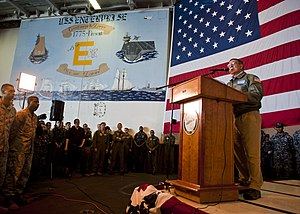 US Navy 120121-N-FI736-318 Secretary of Defense Leon E. Panetta speaks to Sailors and Marines in the hangar bay of the aircraft carrier USS Enterpr.jpg