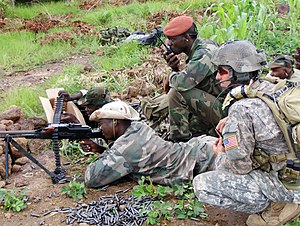 A United States special forces NCO watches weapons marksmanship training for a member of a Malian counter-terrorism unit in December 2010