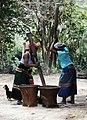 Usui women huskin rice in their coutyard.jpg