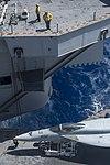 VFA-25 FA-18E Super Hornet being lowered into hangar bay of USS Harry S. Truman (CVN-75) 150907-N-NX690-067.jpg