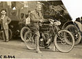 View of motorcyclist posing with Indian motorcycle during 1909 motorcycle races in Indianapolis.jpg