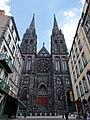 Vue de la façade de la Cathédrale Notre-Dame-de-l'Assomption de Clermont et de son emmarchement rue des Gras.jpg