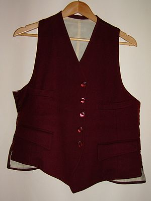 Suit (clothing) - A traditional waistcoat, to be worn with a two-piece suit or separate jacket and trousers.