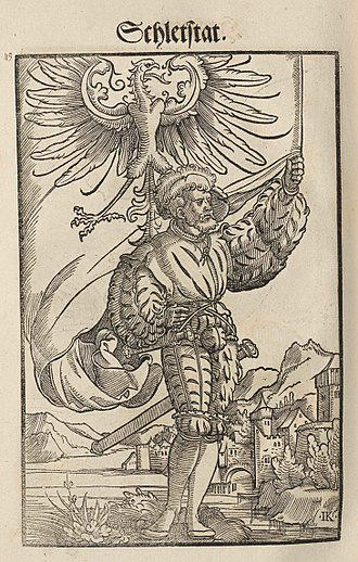 Sélestat - Engraving from Wapen des Heyligen Römischen Reichs Teutscher Nation (1545) with the coat of arms of Sélestat (at that time an eagle instead of a lion).
