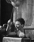 Mary Martin as Nellie Forbush washing her hair onstage