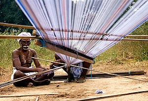 An Indian weaver preparing his warp.