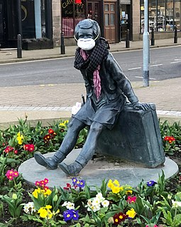 "The ""Wee Annie"" statue in Gourock, Scotland, was given a face mask during the pandemic. Wee Annie, Kempock Street, face mask.jpg"