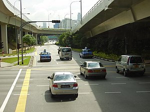 West Coast Highway, Singapore - West Coast Highway extension merges with Keppel Road. The U-shaped exit ramp for vehicles going to the container terminals is in the top left corner of the photo.