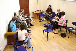 A group of eight people having a discussion