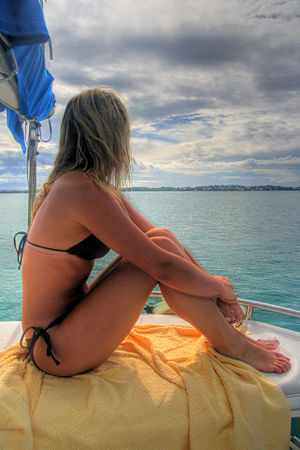 A woman wearing a bikini on a sailboat in the ...