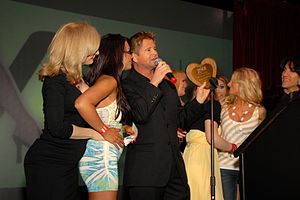 XRCO Award - Cast and crew of the feature Not Bewitched on stage during the 25th Anniversary XRCO Awards at The Highlands, Hollywood, CA on April 17, 2009 (from left to right: Nina Hartley, Eva Angelina, Will Ryder, Flower Tucci, Sunny Lane, who is back to camera in yellow dress, Jenna Haze, Teagan Presley and producer Scott David)