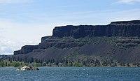 Tall dark escarpment above the lake